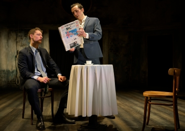 """I do believe, statist though I am none, nor like to be, that this will prove a war."" Posthumus (Adam Goodbody), Philario (Peter Ferneding). Photo by Patrick Baldwin"